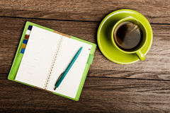 Cup of tea, pen, opened organizer Royalty Free Stock Images