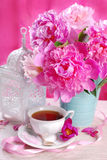 Cup of tea and peony flowers Royalty Free Stock Images