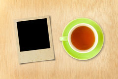 Cup tea and photo frame Royalty Free Stock Photos