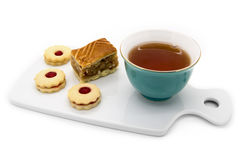 Cup of tea, a piece of apple pie and cookies with jam Royalty Free Stock Photo