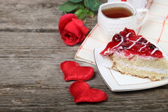 Cup of tea, piece of cake and red heart Royalty Free Stock Image