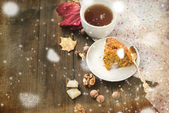 Cup of tea and a piece of carrot cake Stock Image