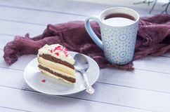 A cup of tea and a piece of tasty creamy cake Royalty Free Stock Photos