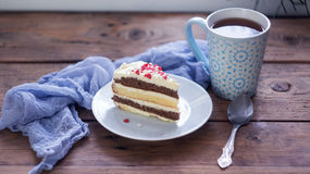 A cup of tea and a piece of tasty creamy cake Stock Photography