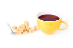 Cup of tea with a pile of sugar cubes Stock Photography