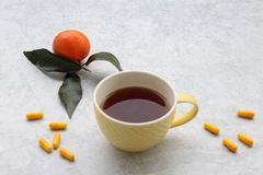 A cup of tea and pills. On marble background royalty free stock images