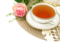 Cup of tea and pink rose - holiday composition Stock Images