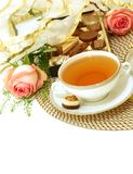 Cup of tea and pink roses - holiday composition Stock Photos