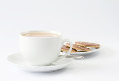 Cup of tea with plate of biscuits Royalty Free Stock Photos