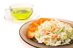 A cup of tea and a plate of salat Royalty Free Stock Images