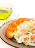 A cup of tea and a plate of salat Stock Images