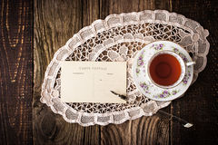 Cup of tea with postcard and pen  top view Stock Image