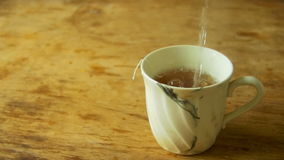 Cup of Tea is Poured Boiling Water in Slow Motion stock video