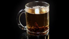 The Cup of Tea is Poured Boiling Water. The Transparent of Glass Cup of Tea Brewed Black Tea stock video