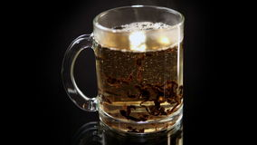 The Cup of Tea is Poured Boiling Water. The Transparent Glass Cup of Tea is Poured Hot Water stock footage
