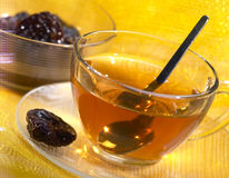 Cup of tea with prunes Stock Photo