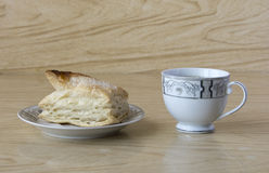 Cup of tea and a puff pastry Stock Photography