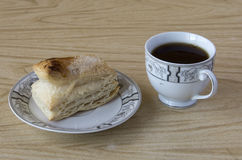 Cup of tea and a puff pastry Royalty Free Stock Photo