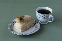 Cup of tea and a puff pastry Stock Images