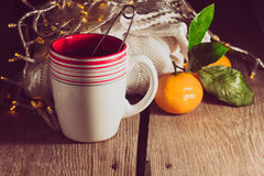 Cup of tea, pullover, tangerine. In a low key selective focus low key Stock Photo