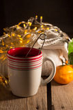 Cup of tea, pullover, tangerine Royalty Free Stock Photo