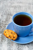 Cup of tea and pumkin cookie Stock Image