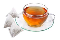 Cup of tea with pyramid teabags royalty free stock image