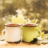Cup of tea at a rainy window autumn mood day leaf. Fall background with copy space royalty free stock images