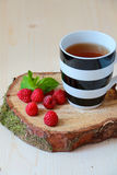 Cup of tea and raspberries Royalty Free Stock Photography
