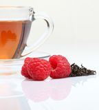 Cup of tea with raspberry Stock Photos