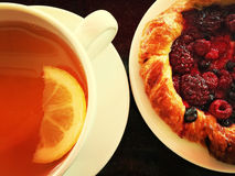 Cup of tea with raspberry pastry Royalty Free Stock Images