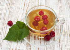 Cup of tea with raspberry Royalty Free Stock Image