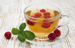 Cup of tea with raspberry Stock Photography