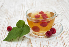 Cup of tea with raspberry. Сup of tea with raspberry  and some fresh raspberries Royalty Free Stock Photography