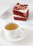 Cup of tea and red cake Stock Images