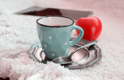 Cup of tea and red heart Royalty Free Stock Images