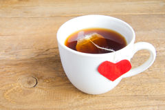 Cup of tea with red heart Royalty Free Stock Photo