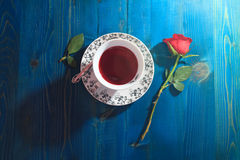 Cup of tea and red rose Royalty Free Stock Photography