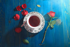 Cup of tea and red rose royalty free stock image