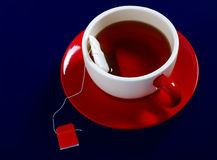 A cup of tea on red saucer Royalty Free Stock Photo