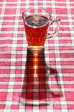 Cup of tea on a red tablecloth Stock Photo