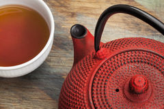 Cup of tea with red tetsubin Stock Image