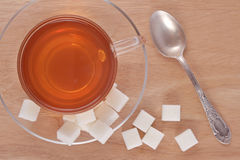 Cup of tea and refined sugar Stock Photos