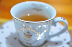 Cup of Tea. A relaxing jasmine tea served on a cute cup royalty free stock photography