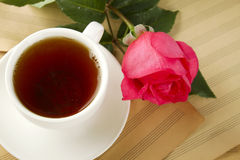 A cup of tea and rose Stock Photos