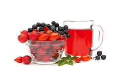 Cup of tea with rose hips and different ripe berries on a white Stock Image