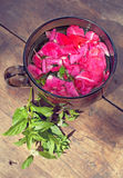 The cup of tea with rose petals and mint Royalty Free Stock Photos