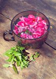 The cup of tea with rose petals and mint Stock Photography