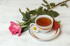 Cup of tea and rose Stock Photos