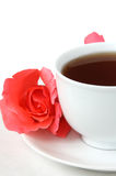 Cup of tea and rosebud Stock Images